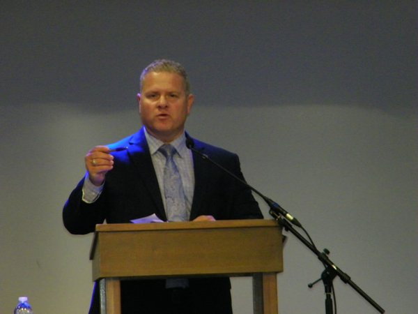 Lance Robertson, dir. of the Aging Services of OKDHS, gives remarks at Fearless Caregiver conference, June 22.jpg